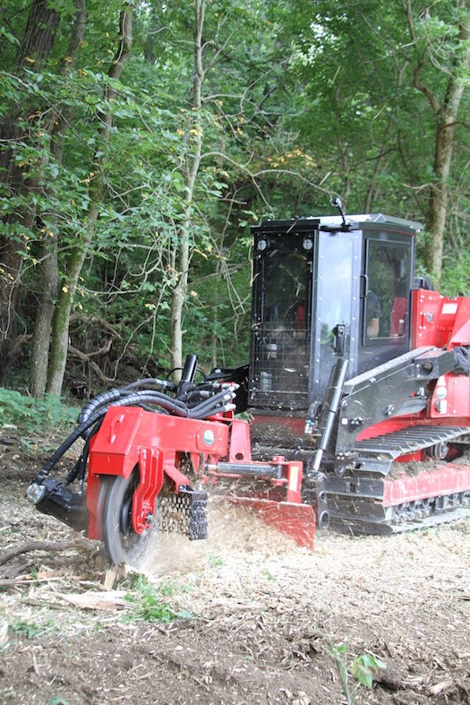 The SH280 Stump Hog stump grinder for Fecon's FTX128 track carrier lets you move quickly and quietly from stump to stump in the comfortable enclosed cab.